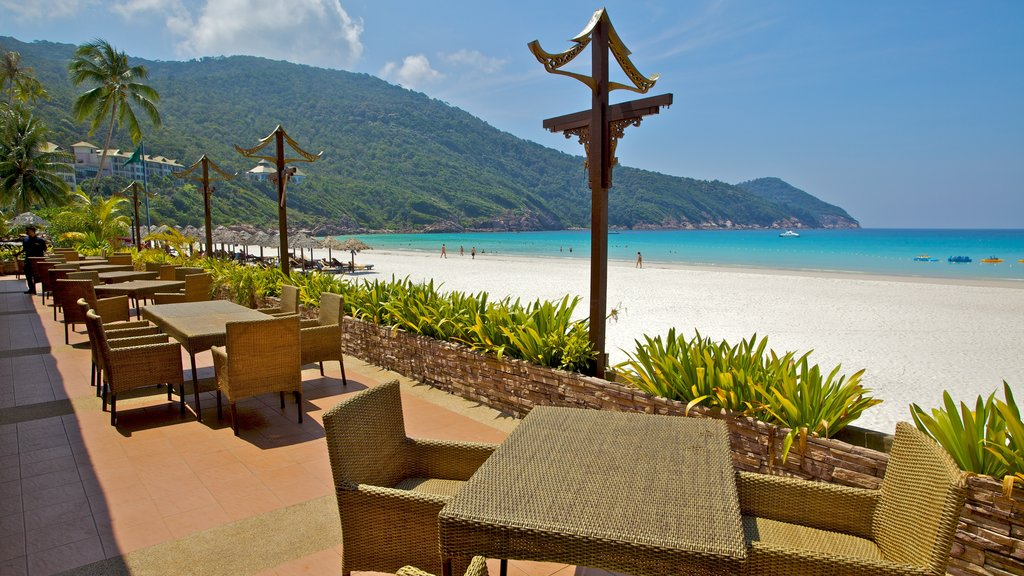 Redang Island featuring a sandy beach, mountains and a coastal town