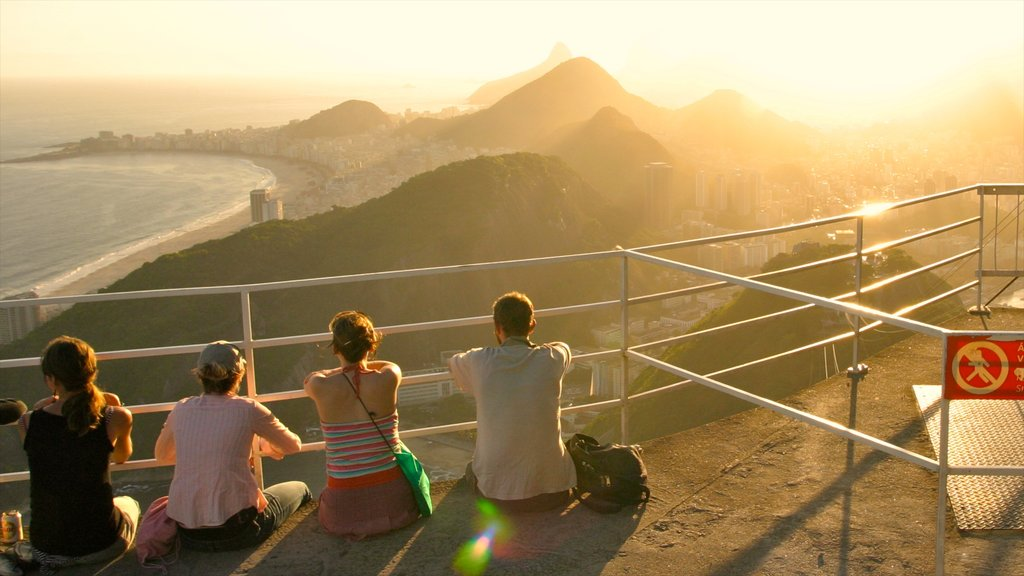 Sugar Loaf Mountain which includes landscape views, a sunset and general coastal views