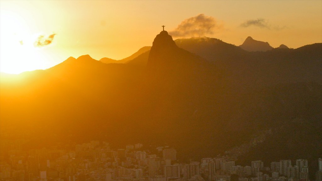 Sugar Loaf Mountain showing mountains, a sunset and a city