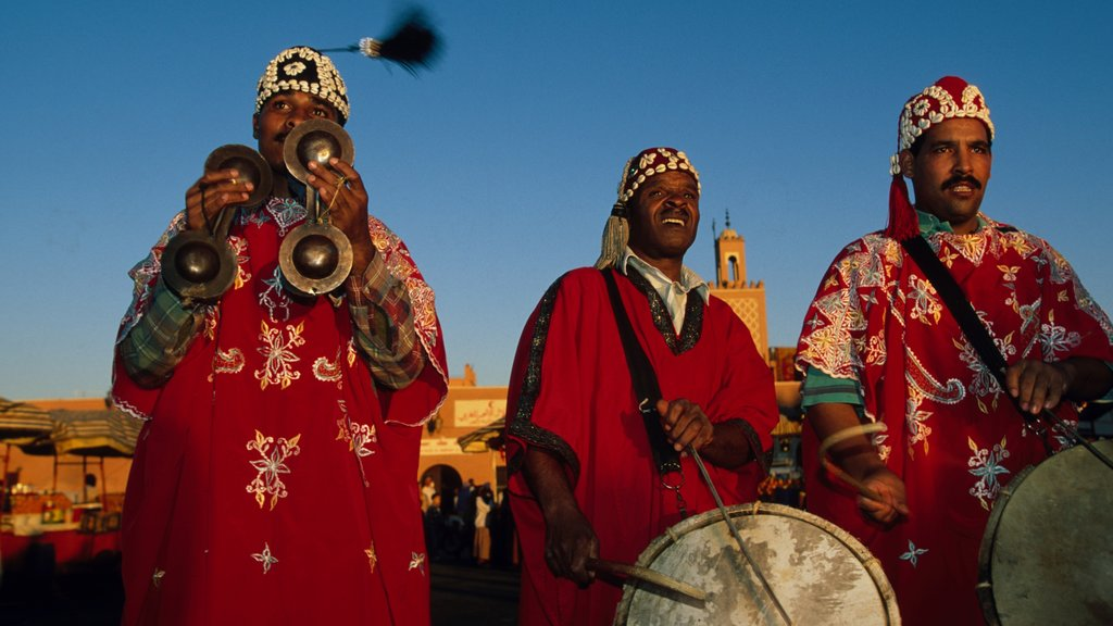 Marrakech featuring performance art as well as a small group of people