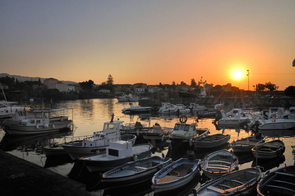 Porto di Ognina al tramonto. By gnuckx  , via Flickr