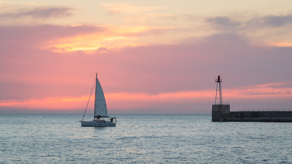 Provence featuring general coastal views, sailing and a sunset