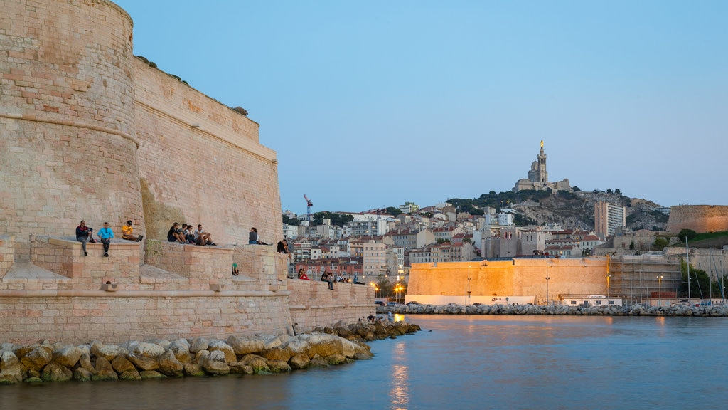 Marseille showing night scenes, heritage elements and a river or creek