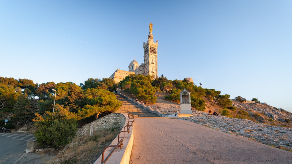 Notre-Dame de la Garde which includes a sunset and heritage elements