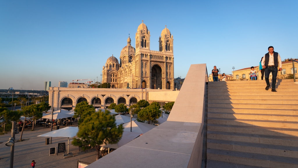 Cathedral la Major which includes a sunset, heritage architecture and a church or cathedral