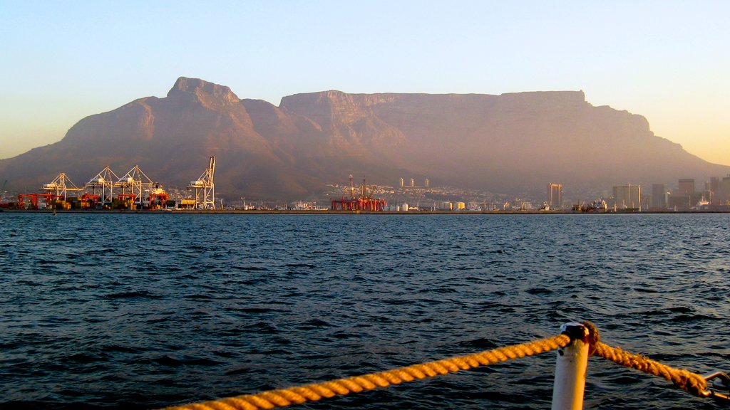 Table Mountain which includes landscape views, mountains and a coastal town