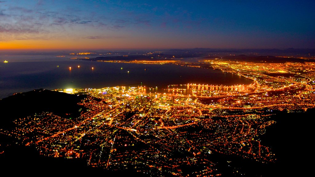 Table Mountain which includes a city, general coastal views and night scenes