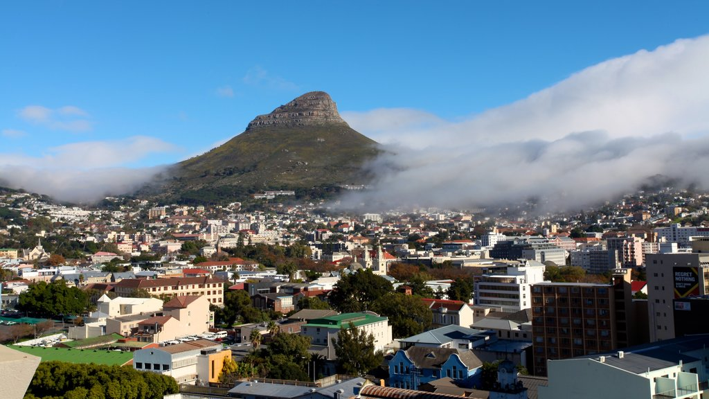 Table Mountain showing mountains, a city and mist or fog