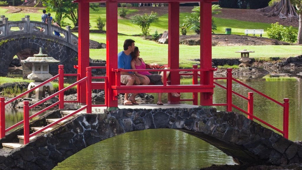 Liliuokalani Park and Gardens which includes a pond, a park and rides