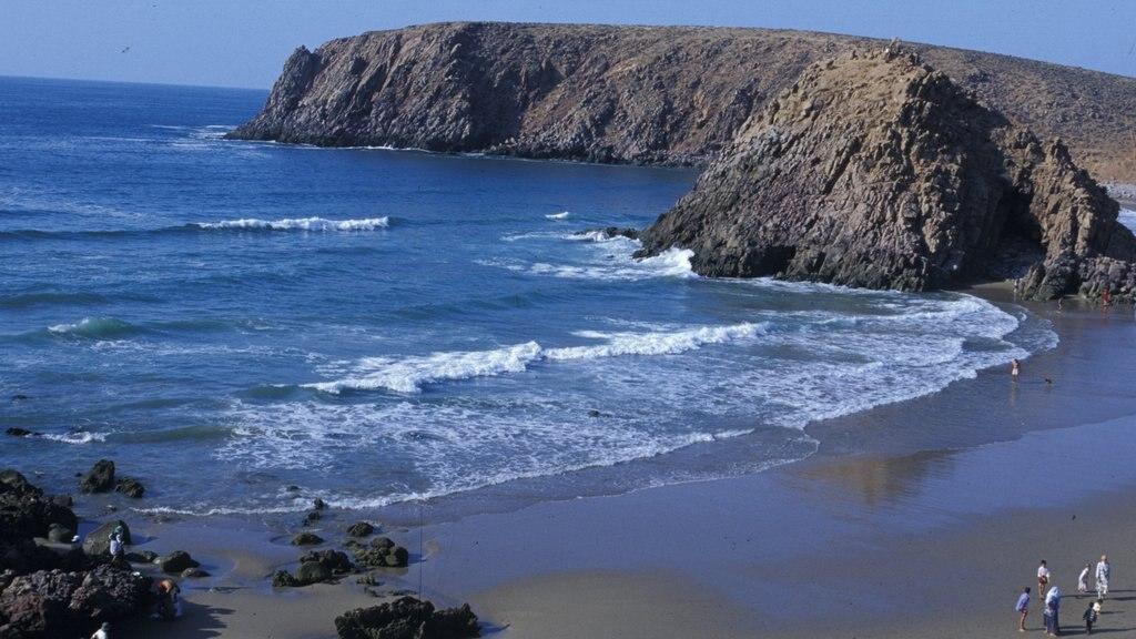Agadir que incluye vistas de paisajes, una playa y costa escarpada