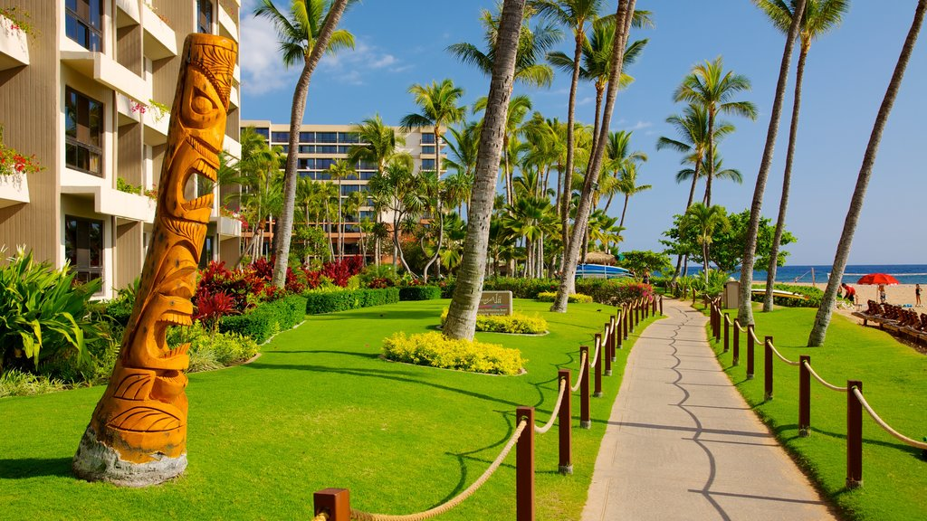 Kaanapali Beach which includes tropical scenes, a coastal town and a beach