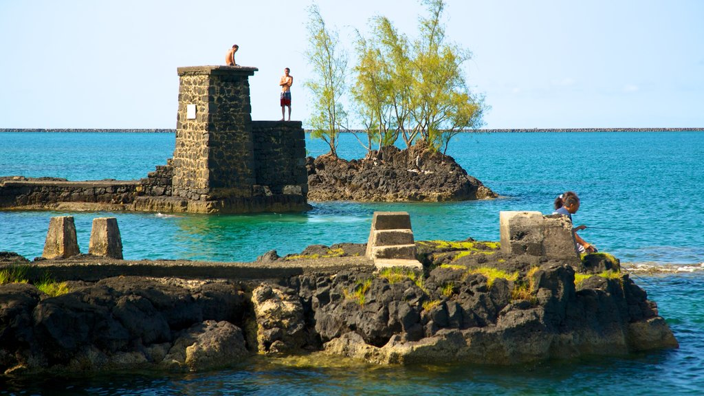 Hawaii featuring views, rocky coastline and heritage architecture
