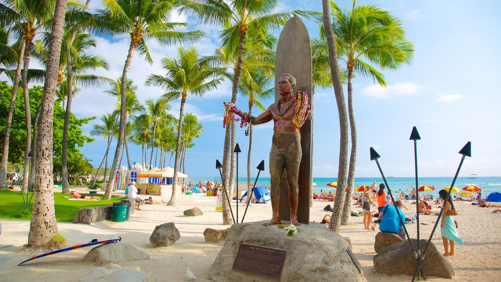 Waikiki Beach which includes tropical scenes, views and a monument