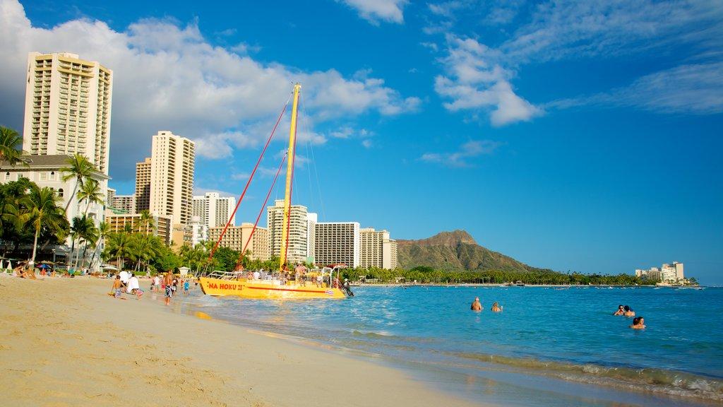 Waikiki Beach showing general coastal views, tropical scenes and swimming