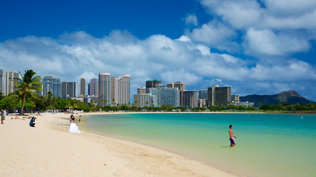 Ala Moana Beach Park featuring modern architecture, tropical scenes and skyline