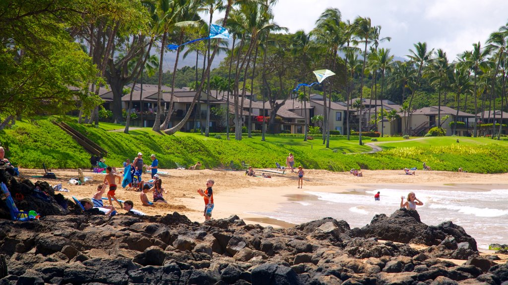 Wailea Beach which includes a sandy beach, a pebble beach and a coastal town