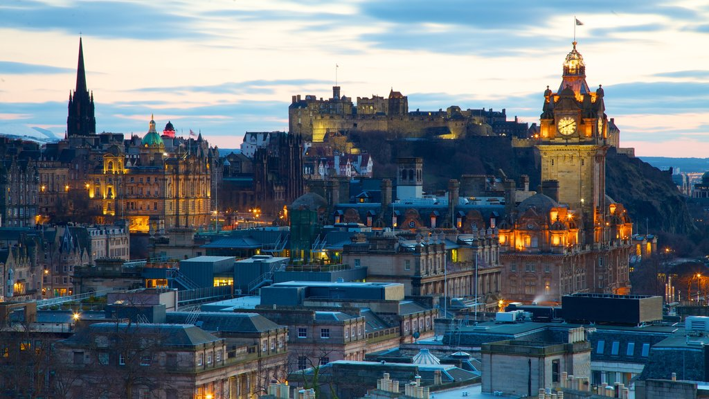 Calton Hill which includes heritage architecture, a city and a sunset