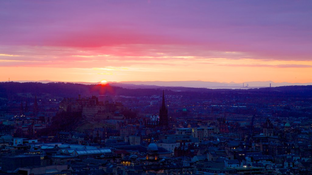 Arthur\\\'s Seat which includes a city, skyline and a sunset