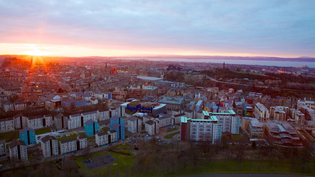 Arthur\\\'s Seat which includes a city and a sunset