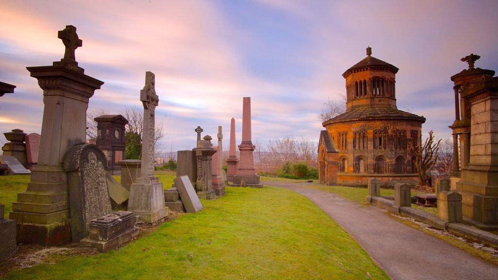 Glasgow Necropolis showing heritage architecture, a sunset and a cemetery