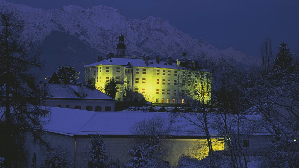 Ambras Castle featuring heritage architecture, a castle and snow
