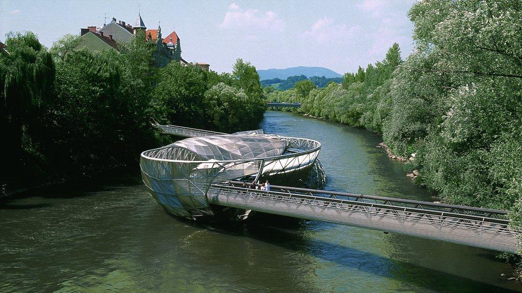 Graz featuring a river or creek, modern architecture and a bridge