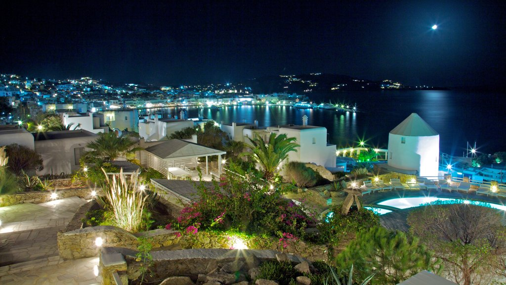 Mykonos Town which includes general coastal views, night scenes and tropical scenes