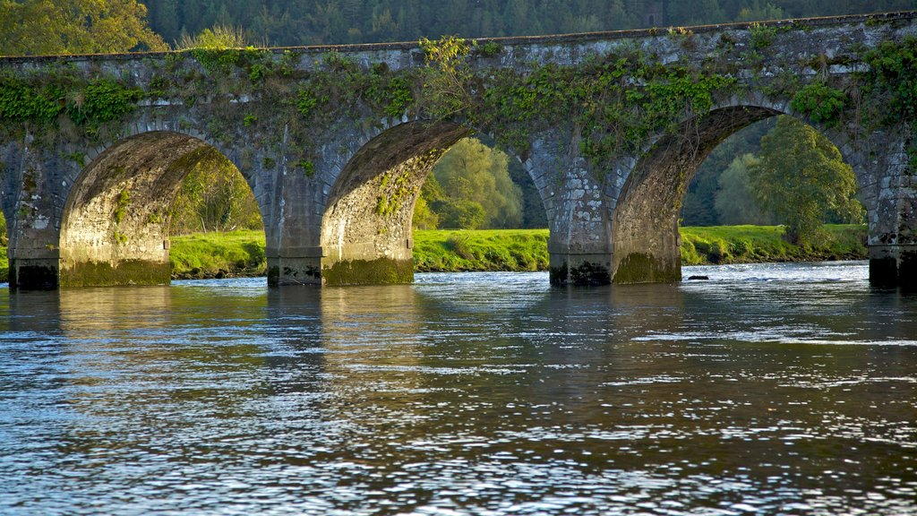 Inistioge which includes heritage architecture and a river or creek