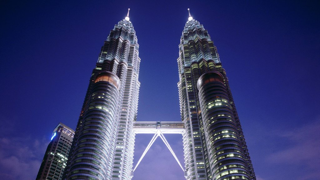 Petronas Twin Towers which includes a skyscraper, a city and night scenes