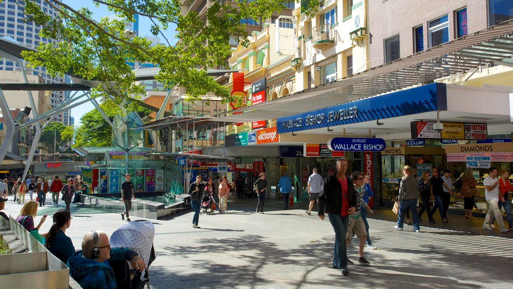 Queen Street Mall featuring shopping, a city and signage