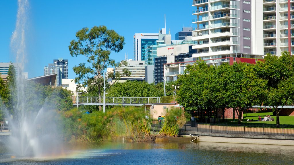 Roma Street Parkland which includes a city, a fountain and a park