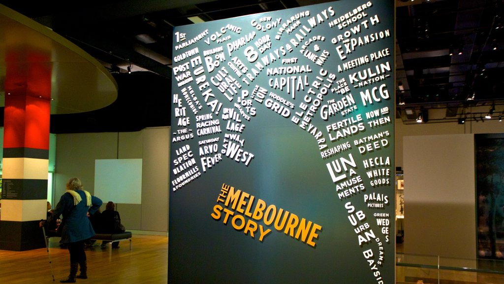 Melbourne Museum featuring signage and interior views