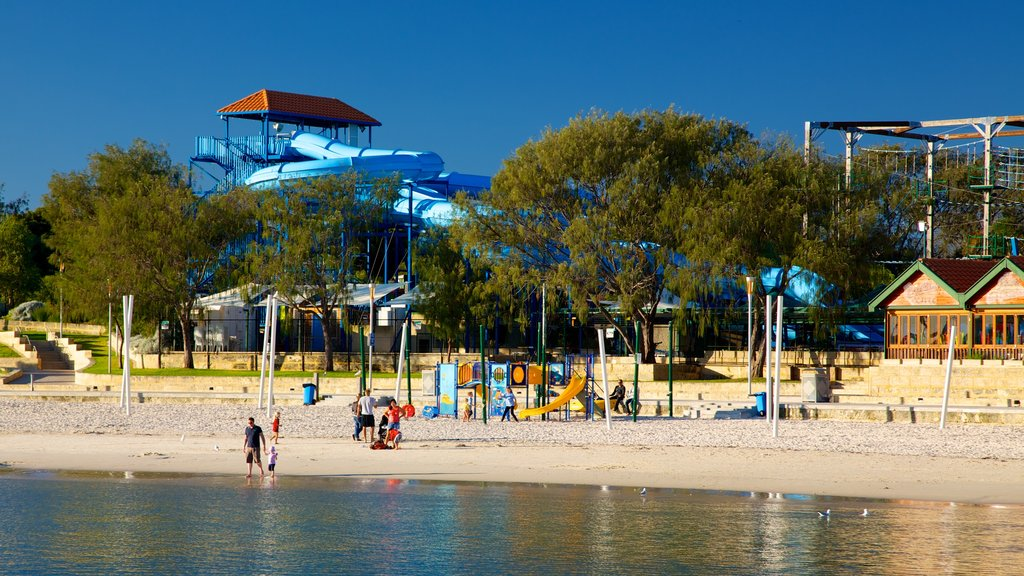 Hillarys Boat Harbour showing a beach, rides and a bay or harbor