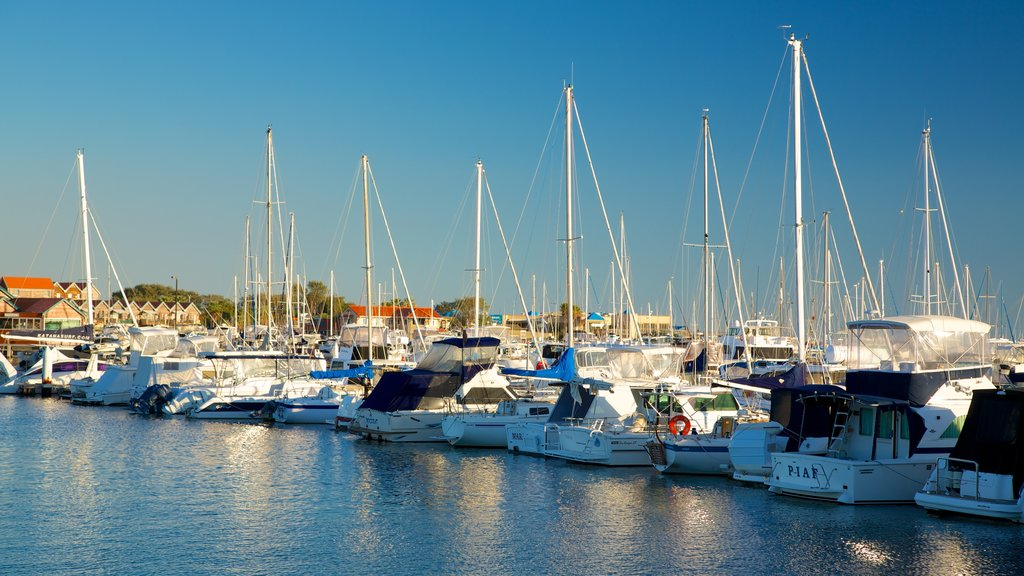 Hillarys Boat Harbour featuring a bay or harbor, a coastal town and boating