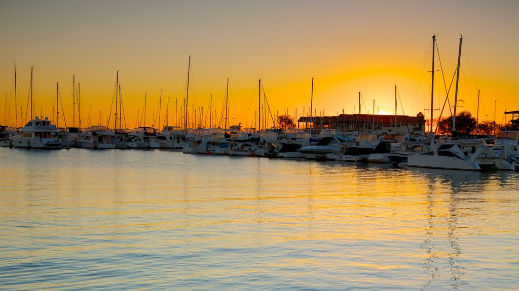 Hillarys Boat Harbour featuring a bay or harbor, boating and a sunset
