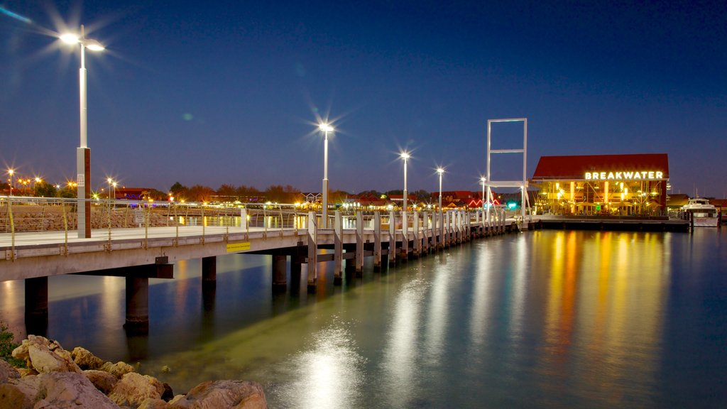 Hillarys Boat Harbour which includes a bridge, night scenes and a coastal town