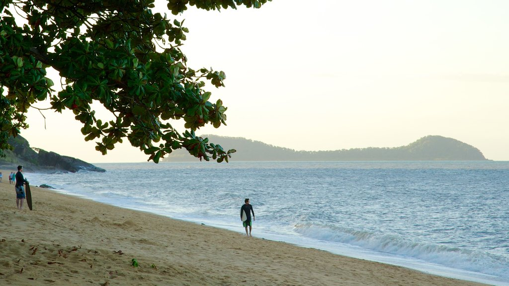 Trinity Beach showing landscape views, tropical scenes and a beach