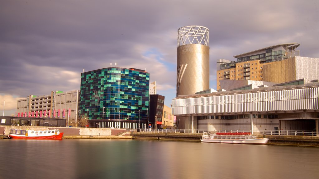 Salford Quays which includes a city, modern architecture and a bay or harbour