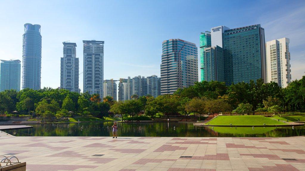 KLCC Park showing a pond, a city and a park