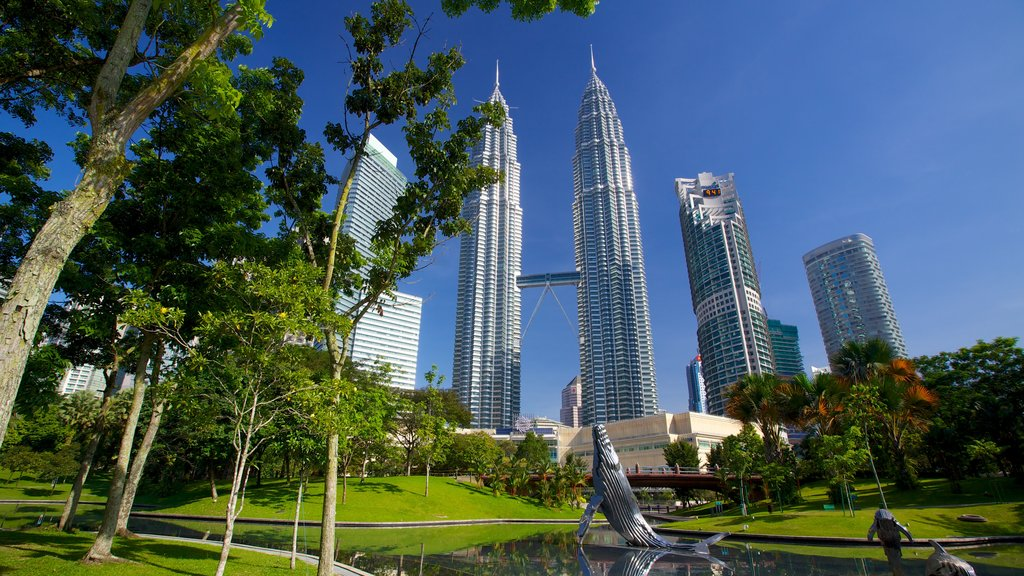 KLCC Park showing a high rise building, outdoor art and a city