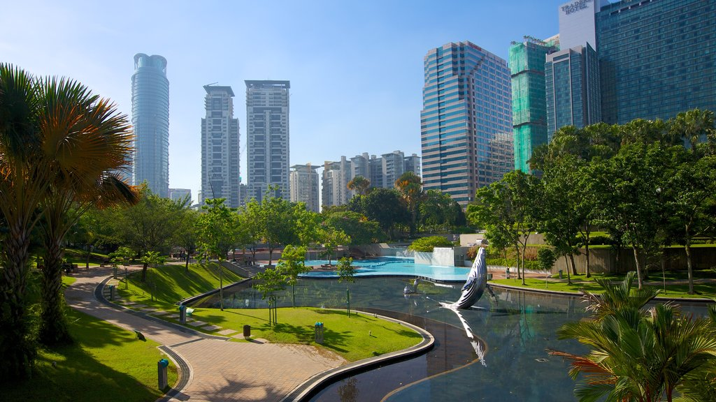 KLCC Park featuring a garden, a pond and a high rise building