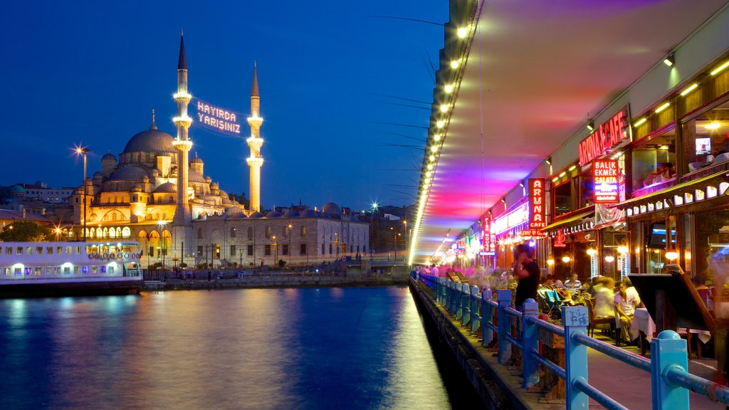 Galata Bridge which includes city views, a ferry and night scenes