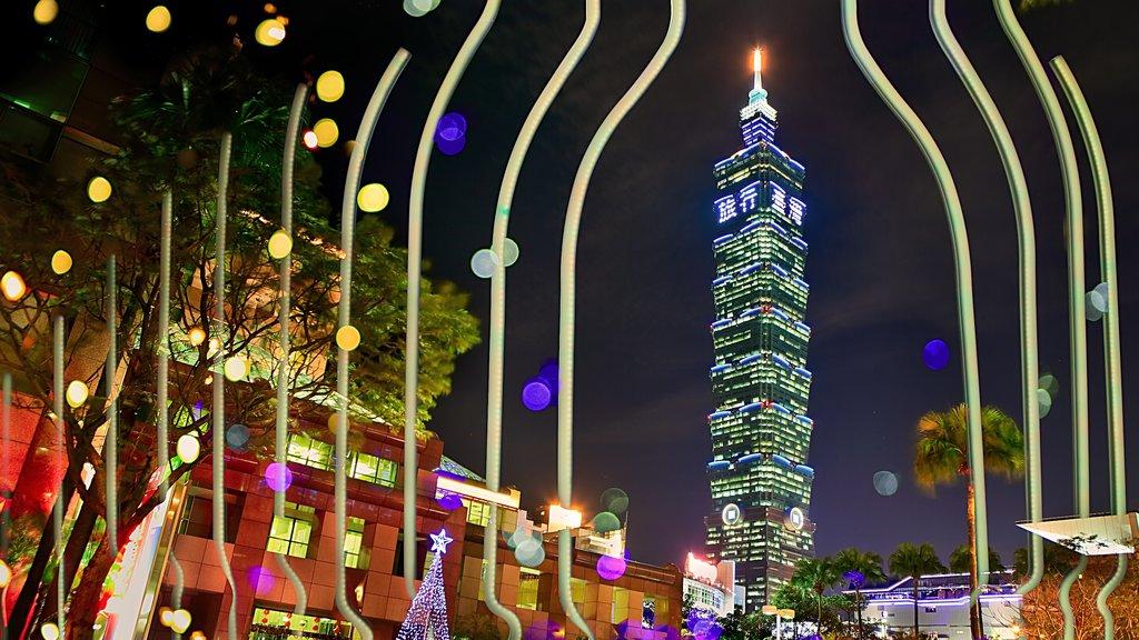Taipei 101 featuring a skyscraper, modern architecture and night scenes