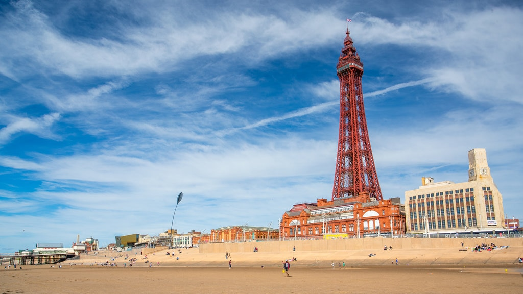 Blackpool Tower featuring a coastal town and a beach