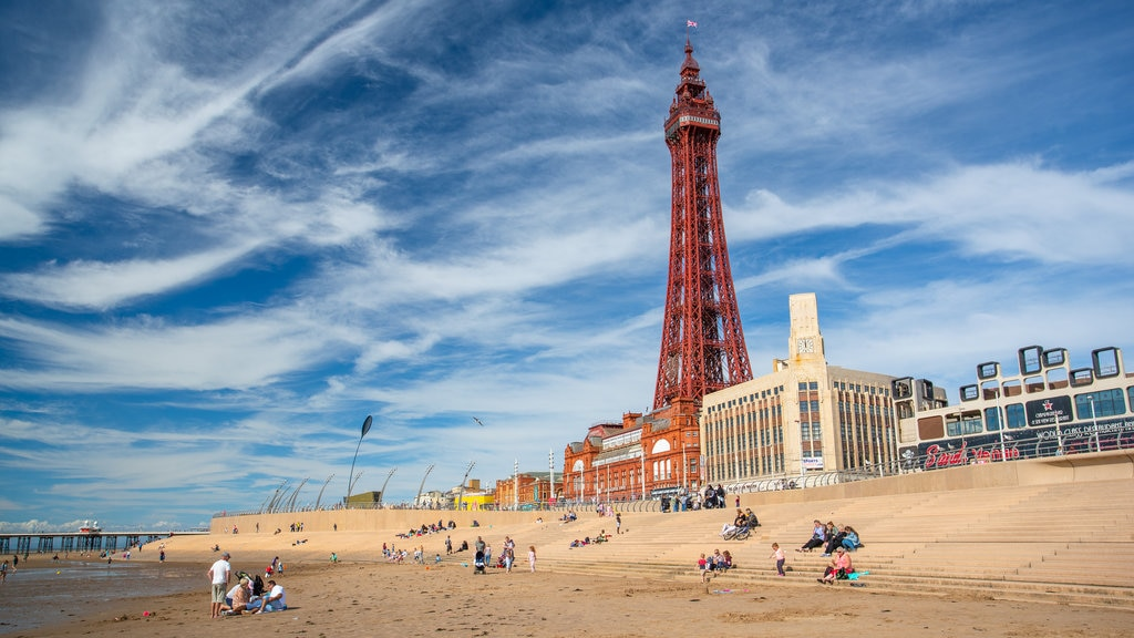 Blackpool Tower which includes a sandy beach, modern architecture and a coastal town