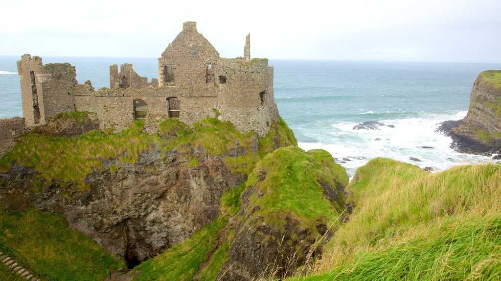 Dunluce Castle showing general coastal views, a gorge or canyon and a ruin
