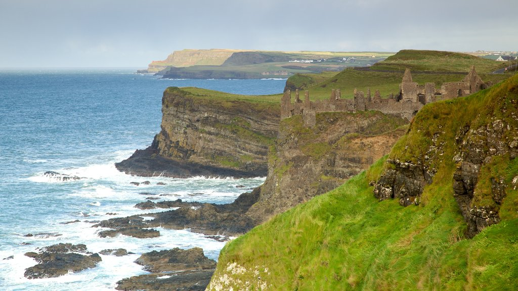 Dunluce Castle featuring rugged coastline and landscape views
