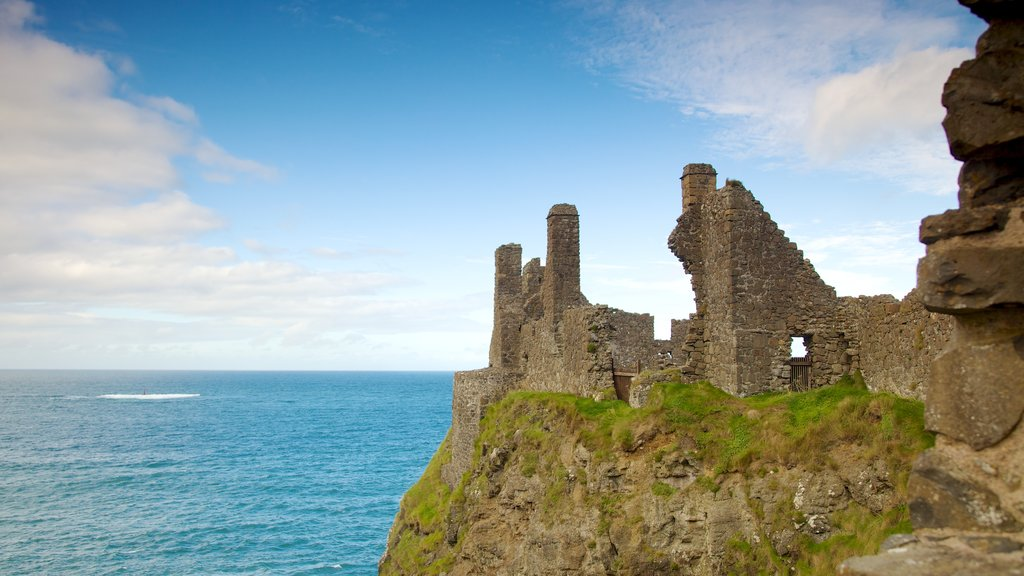 Dunluce Castle which includes general coastal views, building ruins and heritage elements