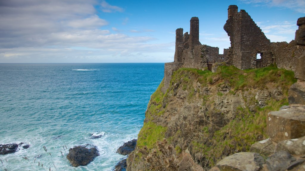 Dunluce Castle which includes a castle, building ruins and rocky coastline