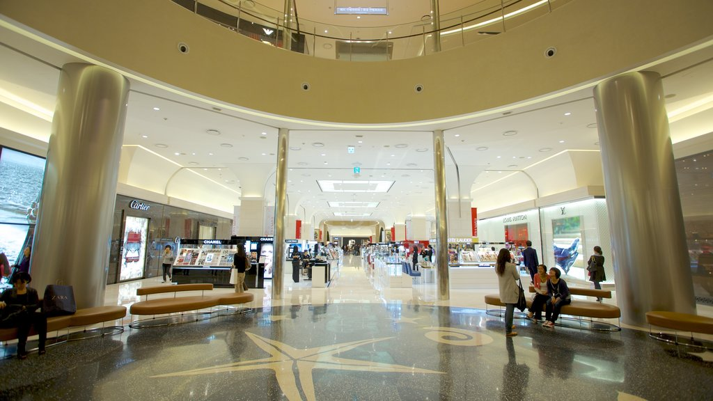 Shinsegae Centum City which includes shopping and interior views